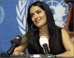 "Mexican actress Salma Hayek, spokeswoman for the global Pampers/UNICEF campaign ""One Pack = One Vaccine"", reacts during a press conference to announce the partnership between UNICEF and Pampers aimed at eliminating maternal and newborn tetanus, at the United Nations building in Geneva, Switzerland, Thursday, Oct. 2, 2008. (AP Photo/Keystone, Martial Trezzini)"