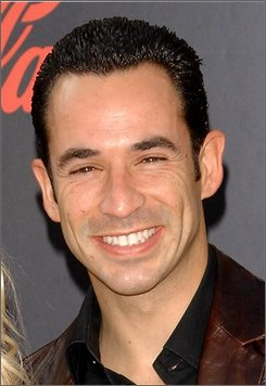 In this Nov. 18, 2007 file photo, Helio Castroneves arrives at the American Music Awards in Los Angeles. A grand jury on Thursday, oct. 2, 2008, returned a tax evasion indictment against the 33-year-old Castroneves, who lives in a Coral Gables mansion.  (AP Photo/Evan Agostini, file)