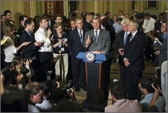 Sen. Max Baucus, D-Mont., center, Sen. Christopher Dodd, D-Conn., 2nd right, Senate Majority Leader, Sen. Harry Reid, D-Nev., right, and Senate Republican Leader Sen. Mitch McConnell, R-Ky., left, speak to reporters after the Senate passed a $700 billion Wall Street rescue plan Wednesday, Oct. 1, 2008 on Capitol Hill in Washington. (AP Photo/Lauren Victoria Burke)