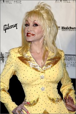 In this June 7, 2007 file photo, Dolly Parton arrives for the 2007 Songwriters Hall of Fame gala in New York. (AP Photo/ Louis Lanzano, file)
