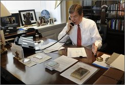 House Minority Whip Rep. Roy Blunt, R-Mo., talks on the phone with Rep. Joe Knollenberg, R-Mich., on the House financial bailout legislation in his office on Capitol Hill in Washington, Friday, Oct. 3, 2008. (AP Photo/Susan Walsh)