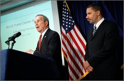 Mayor Michael Bloomberg, left, and Governor David Paterson speak to reporters about the rebuilding of the World Trade Center site in New York, Thursday, Oct. 2, 2008.  (AP Photo/Seth Wenig)