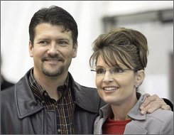 This Oct. 21, 2006 file photo shows Alaska Gov. Sarah Palin standing beside her husband, Todd Palin, in Anchorage, Alaska.  To people in this hard-scrabble region tucked between two soaring mountain ranges, Gov. Sarah Palin is a working-class heroine. As the Republican vice presidential candidate's star rises nationally, she's increasingly held up as the model for life in the Last Frontier.  (AP Photo/Al Grillo, file)