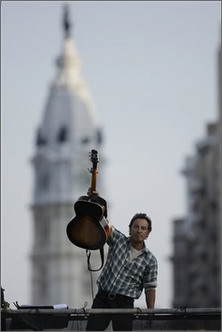 Bruce Springsteen acknowledges the audience at a free outdoor concert in support of Democratic presidential candidate, Sen. Barack Obama, D-Ill., and in a push for voter registration in downtown Philadelphia Saturday, Oct. 4, 2008. (AP Photo/Matt Rourke)