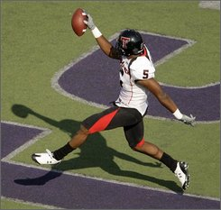 Texas Tech wide receiver Michael Crabtree (5) celebrates in the end zone after scoring a touchdown during the second quarter of a NCAA college football game Saturday, Oct. 4, 2008 in Manhattan, Kan. (AP Photo/Charlie Riedel)