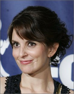 "In this Sept. 16, 2007, file photo Tina Fey is seen in Los Angeles. Fey, already the busiest of stars thanks to her Emmy-winning role in ""30 Rock"" and definitive impersonation of Republican vice presidential candidate Sarah Palin, is working on a book.  (AP Photo/Chris Carlson, File)"