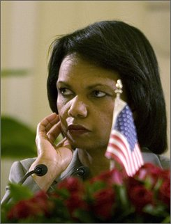  U.S. Secretary of State Condoleezza Rice gestures during a joint press conference with Indian Foreign Minister Pranab Mukherjee in New Delhi, India, Saturday, Oct. 4, 2008. Rice arrived in the Indian capital Saturday to commemorate, but not sign, a historic deal that opens up U.S. nuclear trade with the Asian giant. (AP Photo/Manish Swarup)