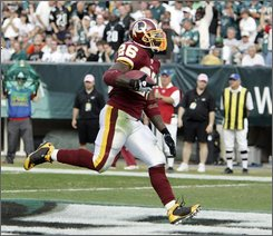 Washington Redskins running back Clinton Portis runs in for a touchdown in the fourth quarter of an NFL football game against the Philadelphia Eagles, Sunday, Oct. 5, 2008, in Philadelphia. The Redskins won 23-17. (AP Photo/Tom Mihalek)