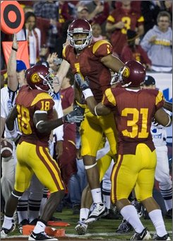 Southern California players, from left, to right, Damian Williams, Patrick Turner, and Stanley Havili celebrate Turner's touchdown against Oregon in the second quarter of an NCAA college football game in Los Angeles, Calif., Saturday, Oct. 4, 2008. (AP Photo/Mark Avery)