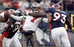 Tampa Bay Buccaneers quarterback Jeff Garcia (7) is sacked by Denver Broncos defensive end Nic Clemons (93) during the fourth quarter of an NFL football game in Denver, Sunday, Oct. 5, 2008. (AP Photo/Jack Dempsey)