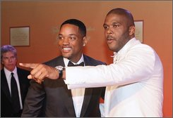 Will Smith, left, is greeted by Tyler Perry at the unveiling of Perry's new motion picture and television studio in Atlanta, Saturday, Oct. 4, 2008. (AP Photo/W.A. Harewood)