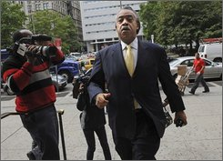 The Rev. Al Sharpton arrives at criminal court Monday, Oct. 6 , 2008, in New York. Sharpton is on trial for the traffic-choking protests over the deadly police shooting of an unarmed New York city man. (AP Photo/ Louis Lanzano)