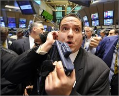  Trader Tom Kalikas works on the New York Stock Exchang floor, Monday Oct. 6, 2008. Wall Street tumbled again Monday, joining a sell-off around the world as fears grew that the financial crisis will cascade through economies globally despite bailout efforts by the U.S. and other governments.  (AP Photo/Richard Drew)