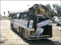 A rear view of the charter bus that overturned, Sunday, is seen in a wrecking yard near Williams, Calif., Monday, Oct. 6, 2008.  Eight people were killed and dozens were injured when the charter bus overturned on a rural road late on it's way to an American Indian casino. (AP Photo/Rich Pedroncelli)