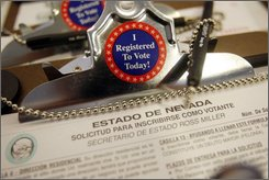 A Nevada registration form is pictured at the Lloyd D. George federal courthouse in Las Vegas, Friday, Aug. 22, 2008. Supporters of Barack Obama and John McCain are fighting for every voter this campaign, and naturalized citizens of Hispanic descent are a growing target. (AP Photo/Isaac Brekken)