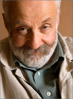 """In this Sept. 8, 2008, file photo, director Mike Leigh from the film """"Happy-Go-Lucky"""" poses for a portrait during the International Film Festival in Toronto. (AP Photo/Carlo Allegri, file)"""