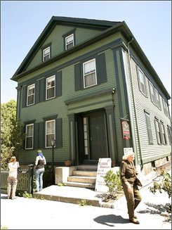In this Aug. 20, 2008, file photo, passers-by walk in front of the Lizzie Borden Bed and Breakfast, in Fall River, Mass. A new museum and shop using the Lizzie Borden name in Salem, Mass., will change its name to settle a trademark infringement case. The agreement reached Monday, Oct. 6, 2008, allows the owner of the inn to continue using the Lizzie Borden name on his business. (AP Photo/Steven Senne)