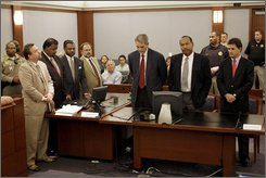 "Co-defendants Clarence ""C.J."" Stewart and O. J. Simpson, second from right standing, and their defense teams listen as the two are found guilty on all 12 charges, including felony kidnapping, armed robbery and conspiracy at the Clark County Regional Justice Center in Las Vegas, Friday, Oct. 3, 2008. The verdict comes 13 years to the day after he was acquitted of double murder charges. (AP Photo/Daniel Gluskoter, Pool)"
