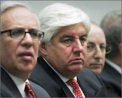 Former CEO of AIG Martin Sullivan, center, is set to testify later today before the House Oversight and Government Reform Committee on Capitol Hill in Washington, Tuesday, Oct. 7, 2008. (AP Photo/Lawrence Jackson)