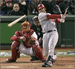 Los Angeles Angels' Mike Napoli shatters his bat in the fourth inning against the Boston Red Sox during Game 4 of baseball's American League division series in Boston, Monday, Oct. 6, 2008. Catching for the Red Sox is Jason Varitek. (AP Photo/Steven Senne)