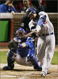In this Oct. 2, 2008 file photo, Los Angeles Dodgers' Manny Ramirez hits a home run off Chicago Cubs starting pitcher Carlos Zambrano during the fifth inning in Game 2 of baseball's National League division series in Chicago.  Ramirez and the Dodgers open the best-of-seven NL championship series against the Philadelphia Phillies, Thursday, Oct. 9, 2008 in Philadelphia. (AP Photo/Pool, Kelvin Ma, File)