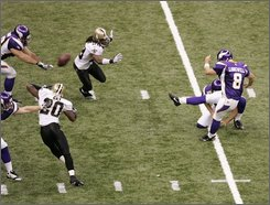 Minnesota Vikings' Ryan Longwell (8) kicks a field goal with 13 seconds left against the New Orleans Saints in an NFL football game in New Orleans, Monday, Oct. 6, 2008. The Vikings won 30-27. (AP Photo/Bill Haber)