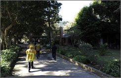 Los Angeles County Fire investigators walk to actor Nick Nolte's house in Malibu, Calif., Tuesday, Oct. 7, 2008, after a fire. Nolte escaped a fire that caused an estimated $1.5 million damage to his Malibu home. (AP Photo/Kevork Djansezian)