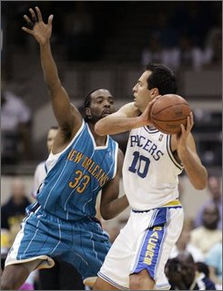 New Orleans Hornets center Melvin Ely, left, defends Indiana Pacers center Jeff Foster in the first quarter of a preseason NBA basketball game in Indianapolis, Wednesday, Oct. 8, 2008. The game was played the in original home of the Pacers, the Coliseum at the Indiana State Fair Grounds. (AP Photo/Michael Conroy)