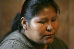 Magdalana Domingo Ramirez Lopez, 29, of Guatemala, tearfully talks about her ordeal a day after being arrested by federal agents  at The House of Raeford's Columbia Farms chicken plant Wednesday, Oct 8, 2008, in Greenville, S.C. Lopez was released for humanitarian reason because of her three young sons who she cares for. (AP Photo/Mary Ann Chastain)