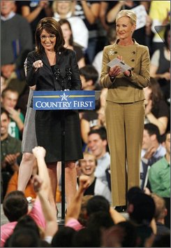 Republican vice-presidential candidate, Alaska Gov. Sarah Palin, left, points to a supporter during a rally for her and Republican presidential candidate, Sen. John McCain, R-Ariz., at Lehigh University in Bethlehem, Pa, Wednesday, Oct. 8, 2008. Standing with Palin is McCain's wife, Cindy McCain. (AP Photo/Tom Mihalek)