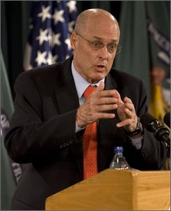 Treasury Secretary Henry Paulson speaks with reporters during a news conference at the Treasury Department Wednesday, Oct. 8, 2008 in Washington.  (AP Photo/Evan Vucci)