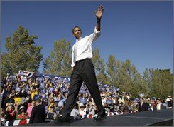 Democratic presidential candidate Sen. Barack Obama, D-Ill., waves to the crowd at a rally at Ault Park in Cincinnati, Ohio Thursday, Oct. 9, 2008.(AP Photo/Alex Brandon)