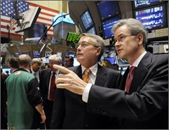Wayne Swan, Treasurer of the Commonwealth of Australia, talks with NYSE Vice President Global Affairs Jeffrey Eubanks, right, during his visit to the trading floor of the New York Stock Exchange, Thursday Oct. 9, 2008. (AP Photo/Richard Drew)