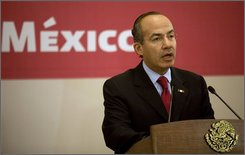 Mexico's President Felipe Calderon speaks at the Los Pinos presidential residence in Mexico City, Wednesday Oct. 8, 2008. Calderon is proposing $4.4 billion in emergency spending next year to boost growth and jobs despite the world financial crisis. (AP Photo/Dario Lopez-Mills)