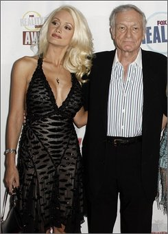 In this Sept. 24, 2008 file photo, Holly Madison, left, and Hugh Hefner arrive at the Fox Reality Channel Really Awards in Los Angeles.  (AP Photo/Matt Sayles, file)