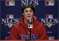 Philadelphia Phillies' Cole Hamels answers a question before baseball batting practice Wednesday, Oct. 8, 2008, in Philadelphia. The Phillies play the Los Angeles Dodgers in Game 1 of the National League championship series on Thursday. (AP Photo/Julie Jacobson)