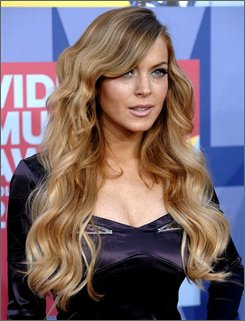 In this Sept. 7, 2008 file photo, Lindsay Lohan arrives at the 2008 MTV Video Music Awards held at Paramount Pictures Studio Lot in Los Angeles. (AP Photo/Chris Pizzello, file)