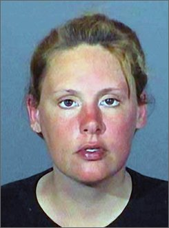 This undated police booking photo released by the Los Angeles Sheriff's Department shows Emily Leatherman, Emily Leatherman was moments away from accepting a deal that would have allowed her to escape state prison. But after she indicated she wasn't entering into the deal freely, a judge rejected the bargain and ordered the 33-year-old to stand trial beginning Friday.  (AP Photo/Los Angeles Sheriff's Department)