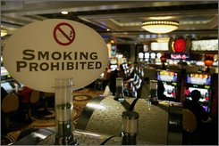 A no smoking sign is seen in an area of Caesars Casino Monday, Oct. 6, 2008, in Atlantic City.  With the economy crumbling and revenues plunging, Atlantic City is considering delaying the start of a total smoking ban at its 11 casinos. The ban, which was approved in April after a year-and-a-half battle between casino workers and gambling hall operators, is set to take effect Oct. 15.  (AP Photo/Mel Evans)