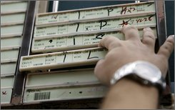 Flight progress strips are seen in the control tower at Washington's Reagan National Airport, Thursday, Sept. 18, 2008. A planned satellite-driven network, dubbed NextGen, would save fuel by ditching radar technology that is more than 50 years old and enabling GPS-equipped planes to fly the shortest route between two points