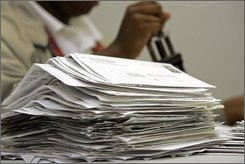A stack of voter registrations are processed at the board of elections in Raleigh, N.C., Wednesday, Oct. 8, 2008. The nationwide boom in voter registration that propelled Sen. Barack Obama to his party's presidential nomination has carried over into the general election, resulting in more than 9 million newly registered voters who are overwhelmingly Democrats and creating the potential for an Election Day landslide. (AP Photo/Gerry Broome)
