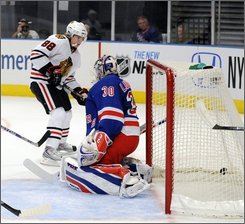 Chicago Blackhawks' Patrick Kane (88) scores past New York Rangers goalie Henrk Lundqvist,of Sweden, during the first period of their hockey game at Madison Square Garden in New York, Friday, Oct. 10, 2008. (AP Photo/Ed Betz)
