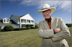 "Actor Larry Hagman poses in front of the  Southfork Ranch mansion made famous in the television show, ""Dallas"",  in Parker, Texas, Thursday Oct. 9, 2008. Hagman was initially reluctant to be on a new TV show called ""Dallas"" when he first read the script in the late 1970s  but is now preparing to celebrate the show's 30th anniversary. (AP Photo/Tony Gutierrez)"