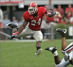 Georgia running back Knowshon Moreno leaps during a run in the first quarter of an NCAA college football game against Tennessee in Athens, Ga., Saturday, Oct. 11, 2008. (AP Photo/John Bazemore)