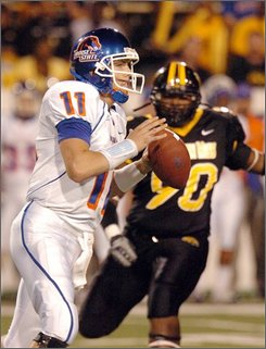 Boise State quarterback Kellon Moore (11) prepares to pass as Southern Mississippi defensive lineman Terrance Pope (90) moves in for the tackle in the first quarter during a NCAA college football game Saturday, Oct. 11, 2008. (AP Photo/Steve Coleman)