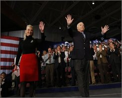 Republican presidential candidate Sen. John McCain, R-Ariz., and his wife Cindy, arrive at a rally in La Crosse, Wis., Friday, Oct. 10, 2008. (AP Photo/Gerald Herbert)