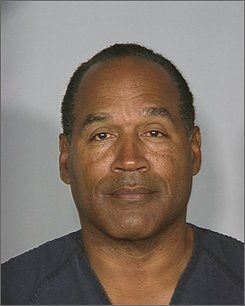 This Friday Oct. 3, 2008, photo, supplied by the Las Vegas Metro Police Department, shows O.J. Simpson after he was taken into custody following his conviction on 12 counts of robbing two sports-memorabilia dealers at gunpoint in a Las Vegas hotel room. Simpson will be held at the Clark County Detention Center -- in isolation for his own safety -- until his sentencing in December and then is expected to be moved to state prison. (AP Photo/Las Vegas Metro Police)