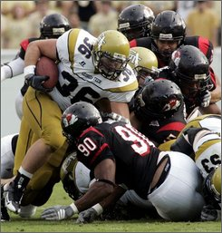 Gardner Webb defenders, including nose tackle Kyle Daye (90), stop Georgia Tech running back Lucas Cox (36) during the second half of an NCAA college football game, Saturday Oct.. 11, 2008, in Atlanta. Georgia Tech won 10-7. (AP Photo/John Amis)