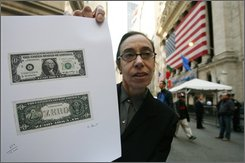 "In this Tuesday, Oct. 7, 2008 file photo, artist Laura Gilbert displays her ""Zero Dollar"" artwork in front of the New York Stock Exchange  in New York. If you're looking to track down your missing money -- figure out who has it now, maybe ask to have it back -- you might be disappointed to learn that is was never really money in the first place. (AP Photo/Mark Lennihan)"