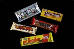 Hershey's Kissables, Milk Duds, Whatchamacallit, Take 5, and Mr. Goodbar are photographed in Harrisburg, Pa., on Sept. 30, 2008. M&M-making rival Mars has crept up on Hershey's dominance of U.S. chocolate buyers. And now, Mars has delivered a chocolate-coated slap in the face, setting up shop in south-central Pennsylvania, just 10 miles from Hershey's flagship factory on Chocolate Avenue.  (AP Photo/Carolyn Kaster)
